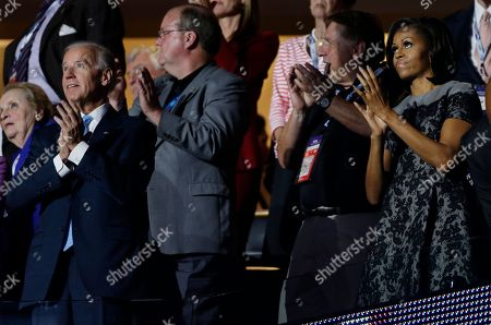 Vice President Joe Biden and First lady Michelle Obama applaud after Sandra Fluke, attorney and women's rights activist's speech at the Democratic National Convention in Charlotte, N.C., on