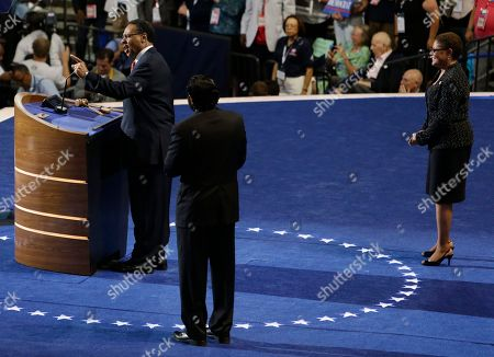 Rep. Al Green of Texas, center and Rep. Karen Bass of California listen as Rep. Emanuel Cleaver II of Missouri addresses delegates at the Democratic National Convention in Charlotte, N.C., on