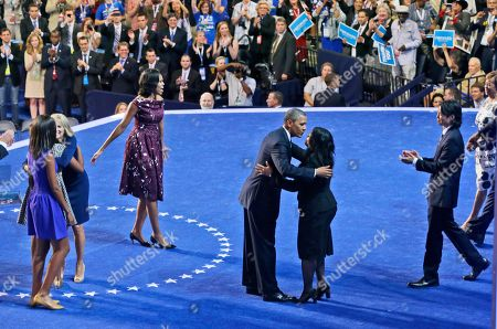 Barack Obama, Michelle Obama, Maya Soetoro-Ng President Barack Obama, center, hugs his half-sister, Maya Soetoro-Ng, as he and first lady Michelle Obama, appear with members of their families on the final day of the Democratic National Convention in Charlotte, N.C