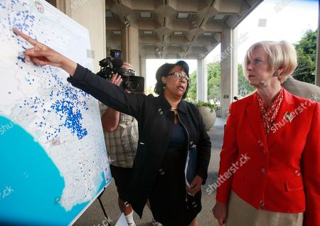 Janice Hahn, Jan Perry City Council member Janice Hahn, right, looks on as Councilwoman Jan Perry points to a map showing location of foreclosed homes during a news conference announcing a lawsuit in Los Angeles. The City of Los Angeles is suing Deutsche Bank, claiming the lender has violated federal, state, and municipal laws by letting hundreds of foreclosed homes become rundown and illegally evicting tenants