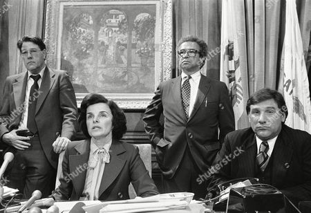 "San Francisco Mayor Dianne Feinstein with president of the Board of Supervisors John Molinari at right,tells newsmen ""There is no excuse for this kind of violence,"" as she talked of the rioting following the verdict in the Dan White murder trial, . Standing at right is aide to the Mayor. At left standing is Police Lt. Dan Murphy"