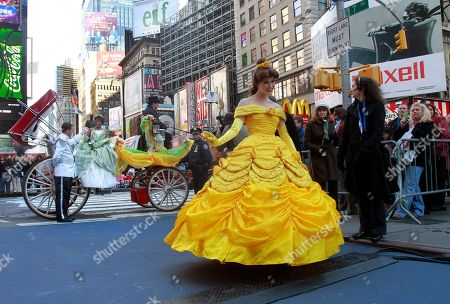 """Disney characters Princess Tiana, from """"The Princess and the Frog,"""" left, embarking a carriage, and Belle, from """"Beauty and the Beast"""" are featured in a sidewalk parade at the grand opening celebration of the premier Disney Store, in Times Square, New York"""
