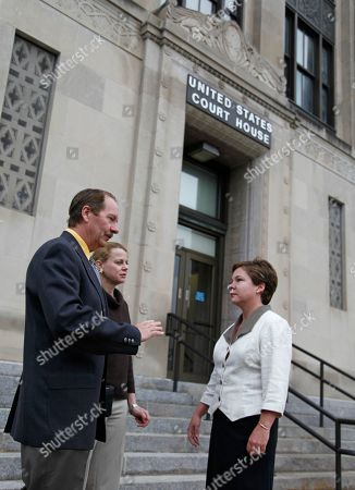 Dorothey Peters Dr. Stephen Schneider and his wife, Linda, of Haysville, Kan., talk with Siobhan Reynolds, president of the New Mexico-based Pain Relief Network, outside of the United State Court House in Wichita, Kan., . The Schneiders are charged with health care fraud, money laundering and unlawfully prescribing drugs in a scheme that prosecutors believe led to more than 100 emergency room visits for overdoses and 68 deaths. The couple is being tried together
