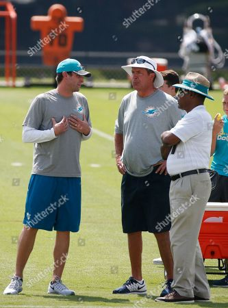 Adam Gase, Dan Marino, Nat Moore Miami Dolphins head coach Adam Gase, left, talks with Dan Marino, center, special advisor to the president and CEO, and Nat Moore, senior vice president, Special Projects and Alumni Relations, as they watch players drill during the NFL football teams minicamp, at the Dolphins training facility in Davie, Fla