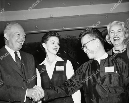 President Dwight Eisenhower greets Harry Aung, 22 year-old exchange student from Burma, at a meeting of the Institute of International Education. Miss Lucinda Greig, center, of Van Buren, Ark., and Mrs. George D. Woods of New York Complete the group. Aung is the 40,000th student brought to this country by the institute. She will study in New Zealand. Mrs. Louise Woods is a trustee of the institute