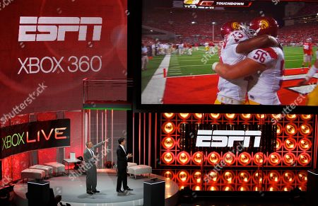 Trey Wingo, Josh Elliot ESPN's SportsCenter co-anchors, Trey Wingo, left, and Josh Elliot announce the ESPN partnership with XBox 360 Live during the 2010 Xbox 360 media briefing at the Wiltern Theater, in Los Angeles