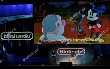 """Warren Spector, Adam Creighton Warren Spector, General Manager & Creative Director, Joint Point, left, and Adam Creighton, Producer Disney Epic Mickey, right, present the new game, """"Disney Epic Mickey"""" for Wii, during Nintendo's E3 presentation at the Nokia Theatre LA LIVE, in Los Angeles"""