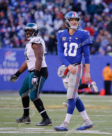 New York Giants quarterback Eli Manning (10) reacts after throwing an interception to the Philadelphia Eagles during the third quarter NFL football game, in East Rutherford, N.J. Philadelphia Eagles strong safety Walter Thurmond (26) intercepted the pass and ran it back for a touchdown. The Eagles won 35-30