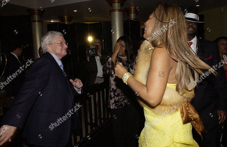 EBERT NORMENT JEAN From left to right, film critic Roger Ebert and his wife, Chaz Hammelsmith Ebert, Lynn Norment, Managing Editor of Johnson Publishing Company, and musician Wyclef Jean dance at Ebony Magazine's Pre-Oscar Salute to Hollywood in Beverly Hills, Calif. on