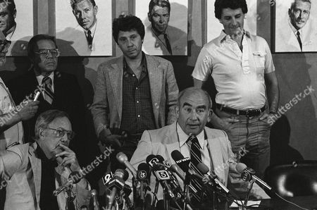 """Ed Asner Stars of the TV series """"Lou Gramnt"""" from left seated Mason Adams, and Ed Asner, with Robert Walden, standing right, appeared at a press conference, Wenesday, for the screen actors guild to express fears that a strike would hurt fellow actors. At left standing is Chester Migden, SAG's chief negotiator. On wall are pictures of former Senator George Murphy and Gov. Ronald Reagan, both former presidents of SAG"""