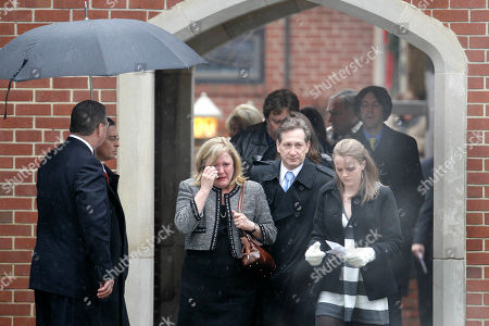 Mourners leave the funeral service for Elizabeth Edwards at Edenton Street United Methodist Church in Raleigh, N.C., . Edwards, the estranged wife of former North Carolina senator and Democratic presidential candidate John Edwards died Tuesday of cancer at the age of 61