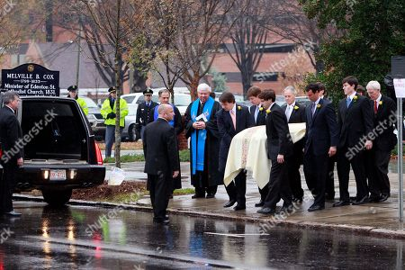 Elizabeth Edwards Pall bearers carry the casket during funeral services for Elizabeth Edwards at Edenton Street United Methodist Church in Raleigh, N.C., . Edwards, the estranged wife of former North Carolina senator and Democratic presidential candidate John Edwards died Tuesday of cancer at the age of 61