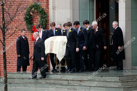 Pall bearers carry the casket during funeral services for Elizabeth Edwards at Edenton Street United Methodist Church in Raleigh, N.C., . Edwards, the estranged wife of former North Carolina senator and Democratic presidential candidate John Edwards died Tuesday of cancer at the age of 61