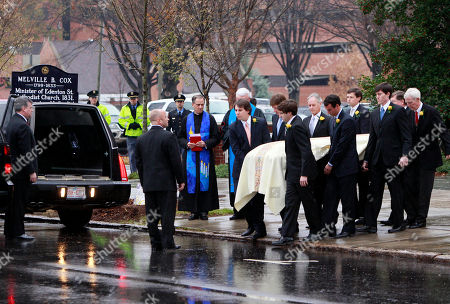 Pallbearers carry the casket containing the body of Elizabeth Edwards towards a hearse following funeral services at Edenton Street United Methodist Church in Raleigh, N.C., . Edwards died Tuesday of cancer at the age of 61