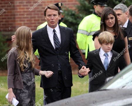 Former Democratic presidential candidate John Edwards and his children, Emma Claire, left, Jack and Cate, far right, leave the funeral service for Elizabeth Edwards at Edenton Street United Methodist Church in Raleigh, N.C., . Edwards died Tuesday of cancer at the age of 61