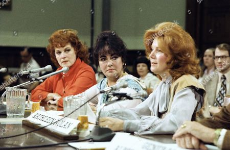 Actress Elizabeth Taylor, center, appeared before a House subcommittee in Washington, D.C.,, in which is considering legislation calling for a gold medal to be struck in John Wayne's honor. Taylor is married to U.S. Senator John Warner, of Virginia. Addressing the committee is actress Kathleen Nolan, president of the Screen Actors Guild