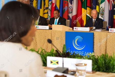 Stock Photo of Joe Biden, Perry Christie, Portia Simpson Miller Vice President Joe Biden, right, sitting next to Bahamas Prime Minister Perry Christie, listen as they attend a multilateral meeting with leaders at the Caribbean Energy Security Summit at the State Department in Washington, . In foreground is Jamaican Prime Minister Portia Simpson Miller
