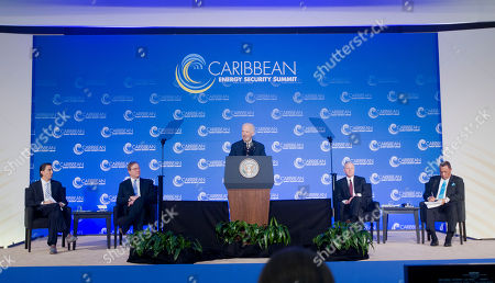 Joe Biden, Amos Hochstein, Fredrick Kempe, Thomas F. McLarty, Perry Christie Vice President Joe Biden, center, speaks at the Caribbean Energy Security Summit, at the State Department in Washington. From left are, State Department Special Envoy for International Energy Affairs Amos Hochstein, Atlantic Council President and CEO Frederick Kempe, Mclarty Associates Chairman Thomas F. McLarty, III, and Bahamas Prime Minister Perry Christie