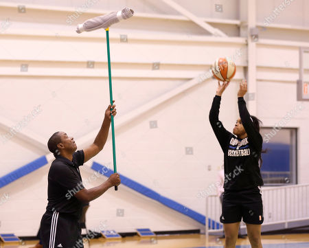 Isiah Thomas New York Liberty President IsiahThomas, left, holds up a broom to help Brittany Boyd work on shooting over defenders after a team practice in Greenburgh, N.Y. The chance to work with the Liberty is a turnaround of sorts for Thomas, too. His last stint in New York ended poorly