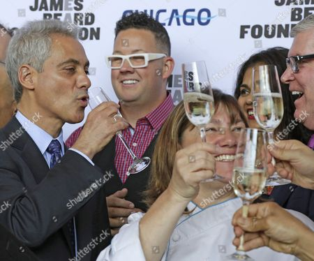 Stock Photo of Rahm Emanuel, Rahm Emanuel, Gale Gand Chicago Mayor Rahm Emanuel, left, toasts with some of the cities top chefs including Grahm Elliott, center, and Gale Gand, lower right, at a news conference, in Chicago. Susan Ungaro, President of the James Beard Foundation, and Emanuel announced that after 24 years in the New York, the James Beard Foundation awards ceremony is moving to the Windy City next year. The foundation - which is based in New York and honors the nation's best chefs, restaurants and food media - says several cities had asked to host the annual awards ceremony, but Chicago's offer of marketing and sponsorship support was too good to turn down