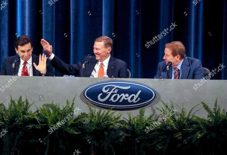 Mark Fields, Alan Mulally, Bill Ford Jr Ford Motor Co. Chief Operating Officer and newly appointed CEO Mark Fields, left, is introduced while current CEO and President Alan Mulally, center, pats him on the back, as Executive Chairman Bill Ford Jr. looks on at the company's annual shareholders meeting in Wilmington, Del., . Fields will take over as CEO when Mulally retires July 1
