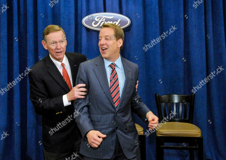 Stock Picture of Alan Mulally, Bill Ford Jr Ford Motor Co. President and CEO Alan Mulally, left, and Chairman Bill Ford Jr., joke around after fielding questions from the media at the company's annual shareholders meeting in Wilmington, Del