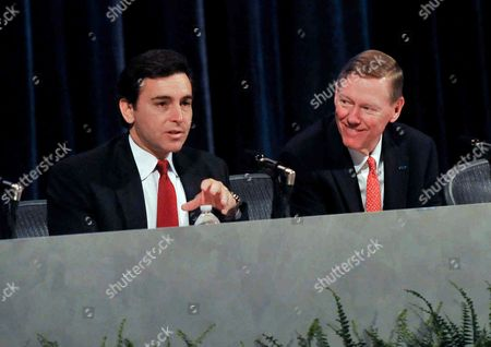 Mark Fields, Alan Mulally Ford Motor Co. Chief Operating Officer and newly appointed CEO Mark Fields, left, addresses the audience alongside current CEO Alan Mulally at the company's annual shareholders meeting in Wilmington, Del., . Fields will take over as CEO when Mulally retires July 1