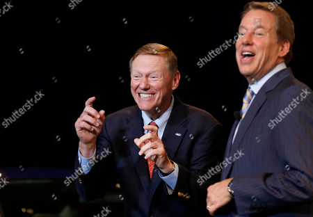 Alan Mulally, Bill Ford Jr Ford Motor Company President and CEO Alan Mulally, left, jokes that a reporter was taking a picture with her phone as Executive Chairman Bill Ford Jr., laughs after a news conference in Dearborn, Mich., . Ford announced CEO Alan Mulally will retire July 1 and be replaced by COO Mark Fields