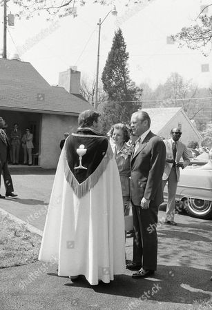 The Rev. Charles Shaffer of the Catoctin Episcopal Church welcomes U.S. President Gerald Ford and Mrs. Bety Ford as they arrive for Easter services at the church in Catoctin Furnace, . The Fords are spending the weekend at Camp David, the presidential retreat in the Maryland mountains