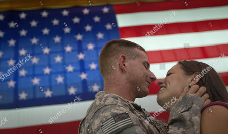Whit Oakes, Lauren Anderson Spc. Whit Oakes, 21, left, of Tampa, Fla., with the U.S. Army's 4th Brigade Combat Team, 101st Airborne Division, embraces his girlfriend Lauren Anderson, 21, of Port St. Lucie, Fla. upon his unit's return home to Fort Campbell, Ky., following a deployment in Afghanistan. The 4th Brigade Combat Team, 101st Airborne Division is returning home after a year in Afghanistan as the last brigade to deploy as part of President Obama's 30,000 troop surge