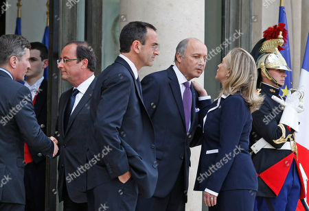 French President Francois Hollande, second left, takes leave of US ambassador to France Charles H. Rivkin, left, as French Foreign Minister Laurent Fabius takes leave of U.S. Secretary of State Hillary Rodham Clinton, right, following their meeting at the Elysee Palace in Paris, . Man at center is Assistant Secretary Philip Gordon