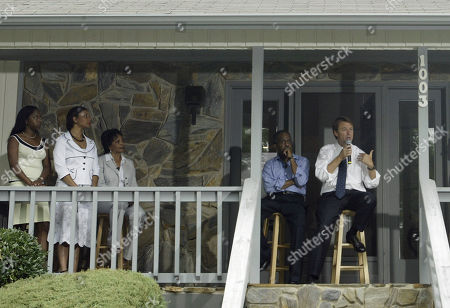 "EDWARDS BELL Vice presidential candidate Sen. John Edwards, right, talks to a private group of invited guests outside the home of Durham Mayor Bill Bell, seated next to Edwards, during a ""Front Porch Visit"" where the private group could ask questions in Durham, N.C., . Bell's daughters Kristen and Anjanee and wife Judith, from left, listen"