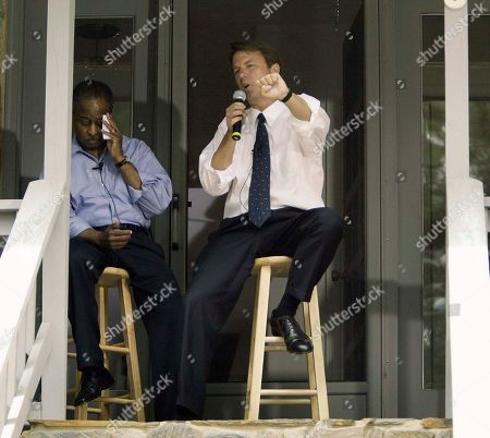 """CAMPAIGN Durham, N.C. Mayor Bill Bell, left, wipes his forehead as Democratic vice presidential candidate Sen. John Edwards speaks to a private group of invited guests during a """"Front Porch Visit"""" at the Mayor's home, in Durham, N.C"""