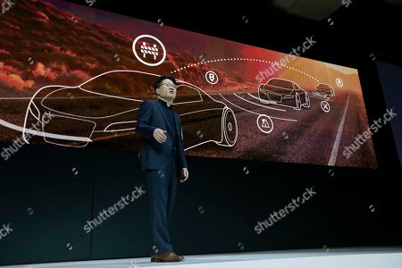 Dr. Skott Ahn, President and Chief Technology Officer for LG Electronics, stands in front of a display as he speaks about automotive technology during a news conference preview for CES International, in Las Vegas. LG unveiled a new OLED 4K TV with HDR, along with several other household electronics items at the news conference