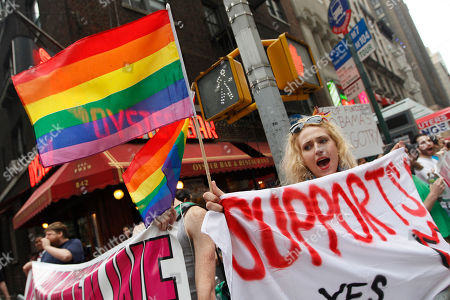 Stock Picture of Gay rights advocate Booker Garrett, of Manhattan, chants slogans during a rally for same sex marriage outside the LGBT gala fundraiser where President Barack Obama spoke, in New York