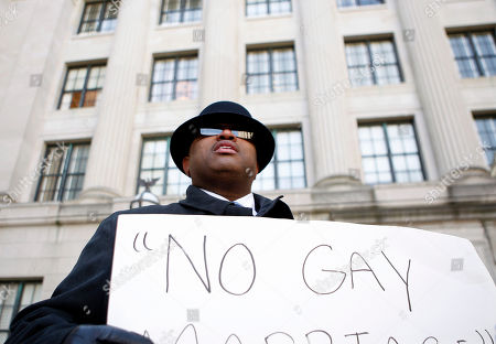 Darren Johnson Darren Johnson, of Philadelphia, holds a sign against gay marriage as he stands outside the New Jersey Statehouse, in Trenton, N.J. The state Senate is scheduled to vote on legalizing gay marriage Thursday. If it passes, the Assembly will vote Monday