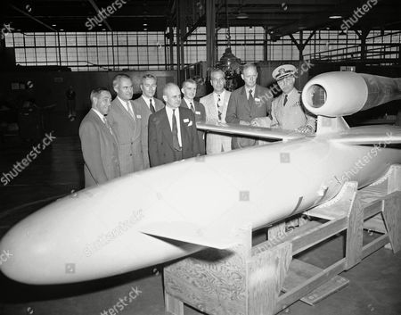 Stock Photo of James Doolittle, Jimmy Doolittle Representatives of the institute of aeronautical sciences toured this navy base as guests of the navy, to inspect latest equipment and developments in guided missiles in Johnsville, Pennsylvania, . Group inspecting one of larger missiles (left to right) Ralph Barnaby, Franklin Institute, Philadelphia; L. B. Richardson, Rear Admiral USN retired now with Curtiss-Wright; Preston R. Bassett, President Sperry Gyroscope Company, Capt. C. E. Kirkbride, commanding officer of base