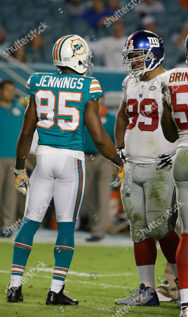 Greg Jennings, Cullen Jenkins Miami Dolphins wide receiver Greg Jennings (85) talks with New York Giants defensive tackle Cullen Jenkins (99)m during the second half of an NFL football game, in Miami Gardens, Fla