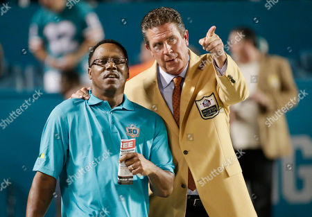 Dan Marino, Mark Clayton Former Miami Dolphins players Dan Marino, right and Mark Clayton talk on the field before an NFL football game against the New York Giants, in Miami Gardens, Fla