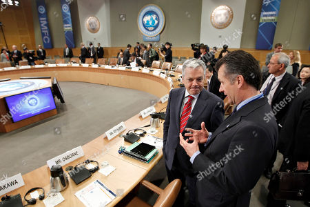 Didier Reynders, Philipp Michael Hildebrand Belgium's Finance Minister Didier Reynders, left, confers with Chairman of the Governing Board of the Swiss National Bank Philipp Michael Hildebrand at the start of a meeting of the International Monetary and Financial Committee (IMFC) at the spring meetings of the IMF/World Bank in Washington