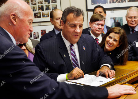 Chris Christie, Mary Pat Christie, Bill Gardner New Hampshire Secretary of State Bill Gardner watches at left as Republican presidential candidate, New Jersey Gov. Chris Christie, with wife Mary Pat, gets ready to sign papers to be on the nation's earliest presidential primary ballot, at The Secretary of State's office in Concord, N.H