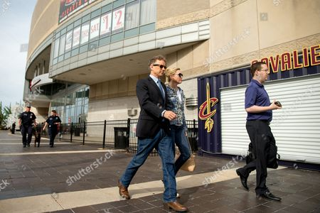 Rand Paul, Kelley Ashby Republican presidential candidate, Sen. Rand Paul, R-Ky., center, and his wife Kelley Ashby, walk outside the Quicken Loans Arena in Cleveland, before tonight's first Republican presidential debate
