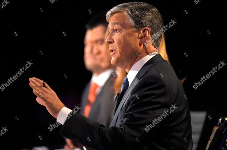 Stock Picture of Debate moderator moderator John Harwood asks a question during the CNBC Republican presidential debate at the University of Colorado, in Boulder, Colo