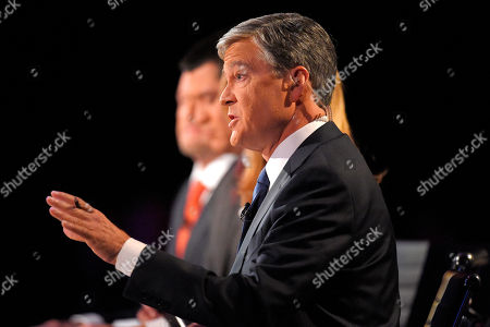 Stock Image of Moderator John Harwood speaks during the CNBC Republican presidential debate at the University of Colorado, in Boulder, Colo