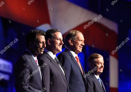 Republican presidential candidates, from left, Bobby Jindal, Rick Santorum, George Pataki, and Lindsey Graham take the stage during the CNBC Republican presidential debate at the University of Colorado, in Boulder, Colo. Chris Christie could be relegated off the main stage at next week's GOP presidential debate and Bobby Jindal and George Pataki risk being shut out altogether, as the trio become potential victims of their poor showings in preference polling and how those polls are being used
