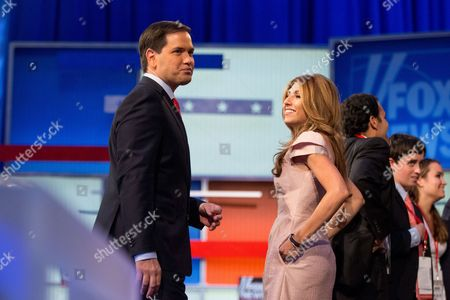 Marco Rubio, Jeanette Dousdebes Republican presidential candidate, Sen. Marco Rubio, R-Fla., left, accompanied by his wife Jeanette Dousdebes, right, stands on stage following the first Republican presidential debate at the Quicken Loans Arena, in Cleveland