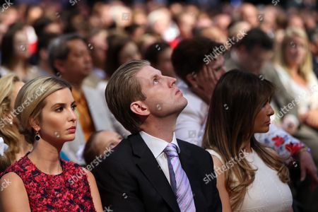 Donald Trump's daughter Ivanka Trump, left, son Eric Trump and wife Melania Knauss watch the first Republican presidential debate at the Quicken Loans Arena, in Cleveland