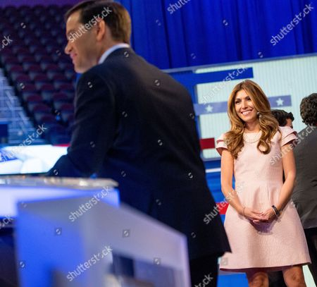 Marco Rubio, Jeanette Dousdebes Republican presidential candidate, Sen. Marco Rubio, R-Fla., left, accompanied by his wife Jeanette Dousdebes, right, thanks the moderators following the first Republican presidential debate at the Quicken Loans Arena, in Cleveland