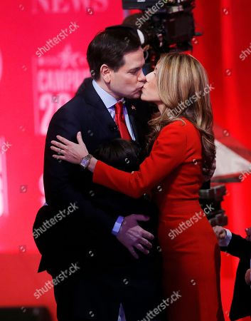 Republican presidential candidate, Sen. Marco Rubio, R-Fla., kisses his wife Jeanette Dousdebes Rubio after the CBS News Republican presidential debate at the Peace Center, in Greenville, S.C
