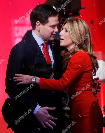 Republican presidential candidate, Sen. Marco Rubio, R-Fla., embraces his wife Jeanette Dousdebes Rubio after the CBS News Republican presidential debate at the Peace Center, in Greenville, S.C